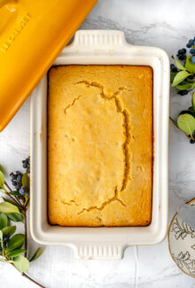 overhead shot of vegan cornbread in a le creuset ceramic yellow dish on a marble table